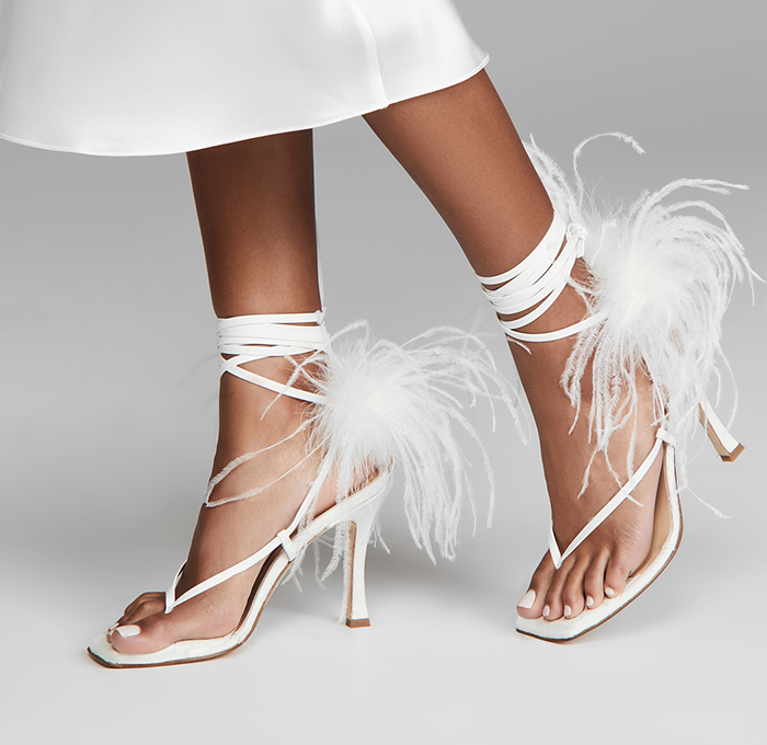Bridal Shoes with Feathers 2020. Feather Embellished Bridal Shoes 2020. White Bridal Shoes with Feathers 2020. Where to find the best Bridal Shoes 2020. White Feather wedding shoes 2020. Best Shoes for Summer Brides. Fall Wedding Ideas 2020. Luxury Wedding Shoes 2020.