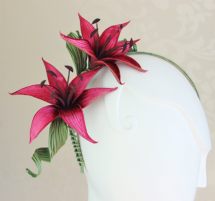 Lillies for the fillies fascinator. Fascinators for Kentucky Oaks day 2021. Mother of the Bride fascinators 2021. Fascinator with Lily Flowers 2021. Mother of the bride outfit ideas 2021. Mother of the Groom fascinator. Spring Wedding Outfit Ideas 2021.
