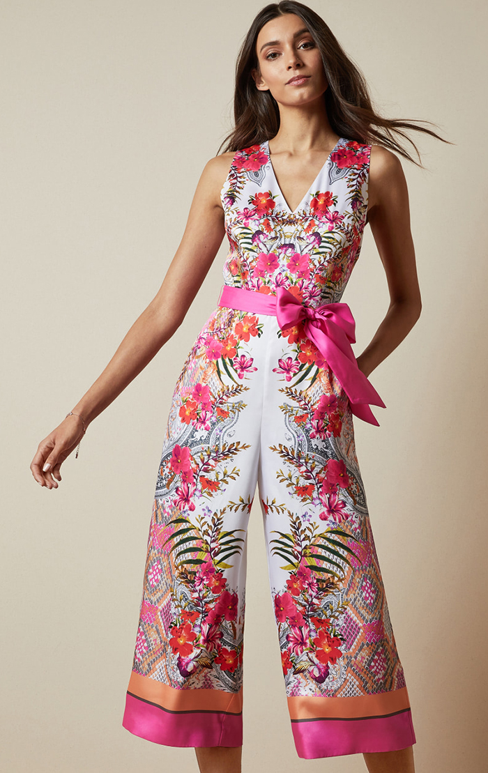 Ted Baker Pink Jumpsuit for Kentucky Derby 2021. Pink Jumpsuits for Kentucky Oaks 2021. Summer Wedding guest outfits USA 2021. Outfit ideas for Summer Weddings 2021. Pink outfits for Kentucky Derby Oaks Day 2021. Bright Pink Fitted Dress 2021. What to wear to the Kentucky Oaks 2021. Floral Pink Jumpsuits 2021.