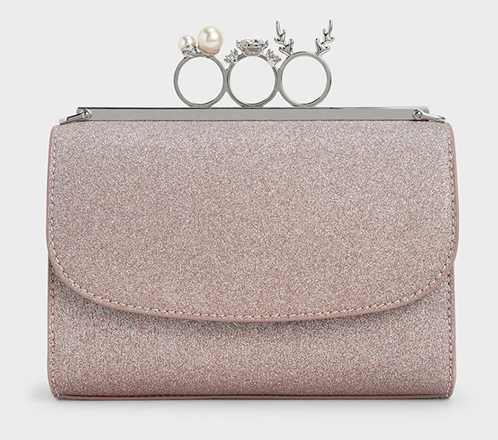 Pink Glitter Clutch Bag for weddings. Mother of the Bride Clutch Bags. Pale Pink Mother of the Bride Outfits 2021. Rose Gold Wedding Outfits for Mother of the Bride 2021. Knuckle Clutch Bag. Rose Gold Spring Wedding outfit ideas 2021.