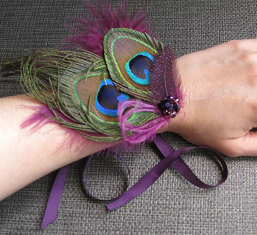 Peacock Feather Wrist Corsage. Mardi Gras Outfits. Mardi Gras Wedding theme. Ideas for a Mardi Gras Wedding. Mardi Gras Bridesmaids